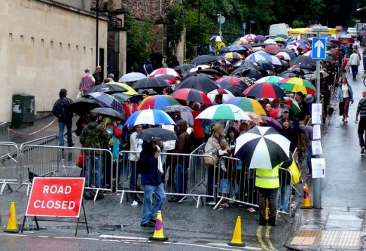 Queue with umbrellas.