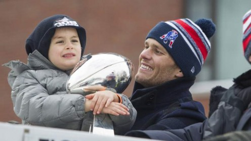 Brady's youngest son,  Benjamin and a happy Tom Brady at Super Bowl  parade 2015