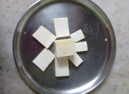 Ready made cottage cheese cut into cuboids