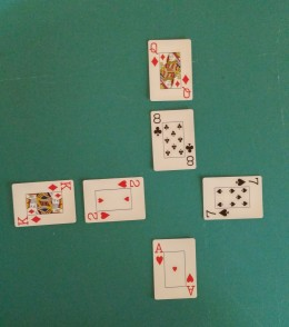 Bottom Center Card Turned To Play With Vertical Column