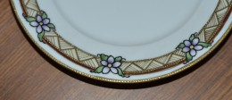 Fine detail on hand painted china, done using gold paint. Noritake era.
