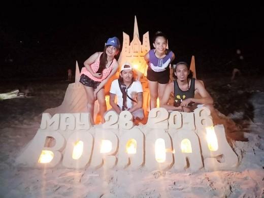 Selfies by the sandcastle