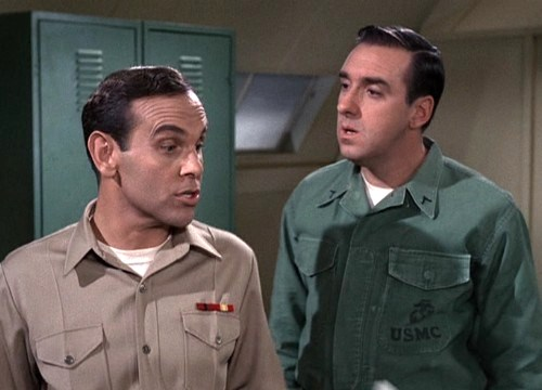"""Corp. Schell orders  Jim Nabors, """"Gomer  Pyle,"""" on a specific  marching routine"""