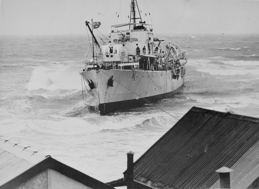 Here's my old ship, HMAS Barcoo, aground of Glenelg Beach in South Australia in the 1950s