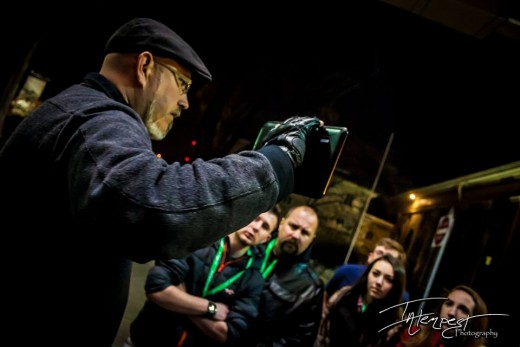 A  tour guide with haunted Knoxville Ghost Tours prepares to take a group of tourists out for an evening of paranormal investigations.