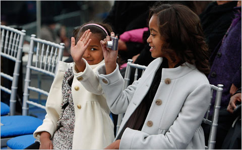 Sasha Obama, blocks her sister Malia's viewfinder.  Malia got interested in photography at an early age.