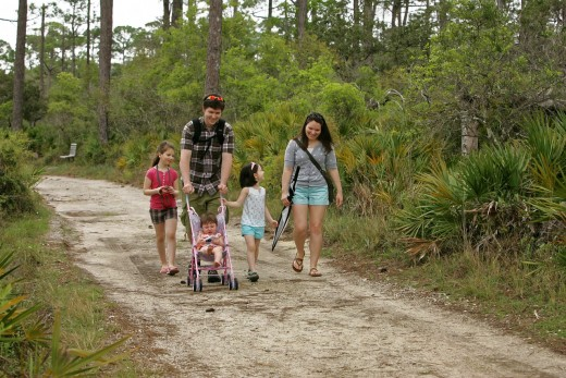 A couple walking with 3 kids.