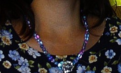 Here is the necklace I made with the flower button.
