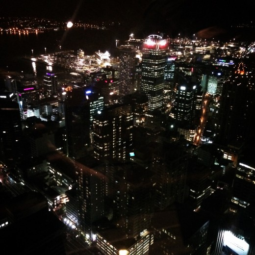 Views of the lit city at night from the Sky Tower (Auckland, North Island)