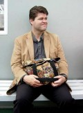 What do you think of a man who refuses to hold a woman's purse, even for a minute?