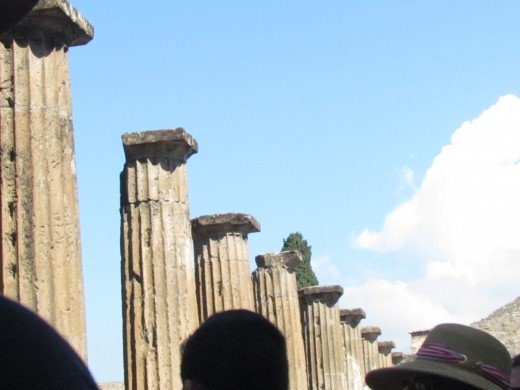 Ruins of columns within the Pompeii tour. This Roman city was destroyed and buried under volcanic ash and pumice in the eruption of Mount Vesuvius in AD 79.