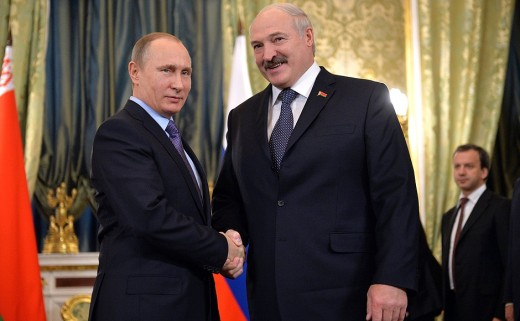 Russian president Vladmir Putin(short guy) shaking hands with Alexander Lukashenko(big guy)