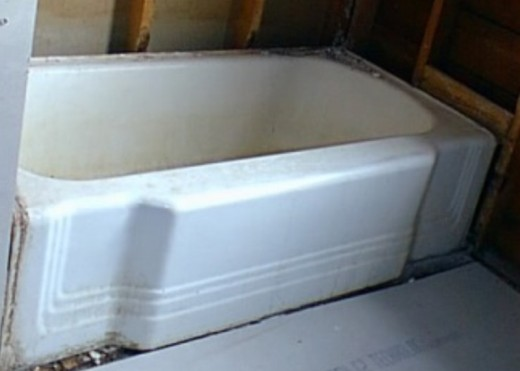 The old cast iron bathtub had to be removed and replaced with a new one. It took two men to carry it out.