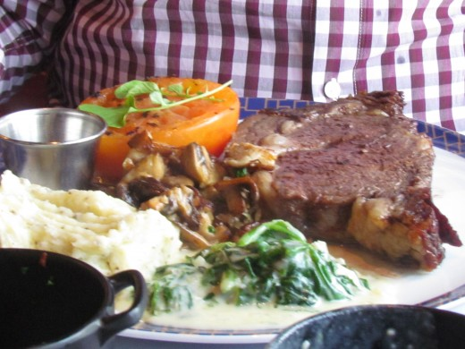 Walker chose prime rib with, onion rings, potatoes and vegetables.