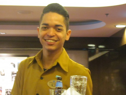 One of the extremely considerate and professional waiters that served us at our favorite lounge on Deck 7 near the elevators.