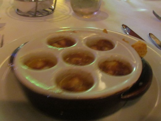 Scallops were served as an appetizer before the main course.