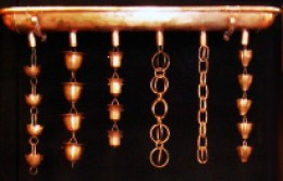 You can see a variety of styles of rain chains here.  Photo by http://www.flickr.com/photos/rutlandguttersupply/3648511850/
