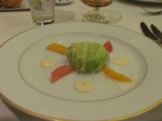 An appetizer of Lump Crab Cake with horseradish, mango and orange sauce with citrus. It was wrapped in lettuce  we enjoyed before dinner at the Le Bistro.
