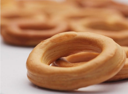 """This stems from the Ilonggo word meaning """"bracelet"""" or """"bangle"""" having the distinct shape of this delicacy. They are baked to perfection, golden brown at that, and are a great pair for coffee, juice or tea. Kids can even wear it on their wris"""