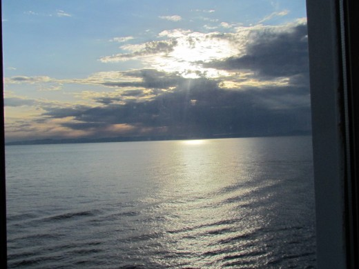 A beautiful sunset from the balcony of our stateroom.