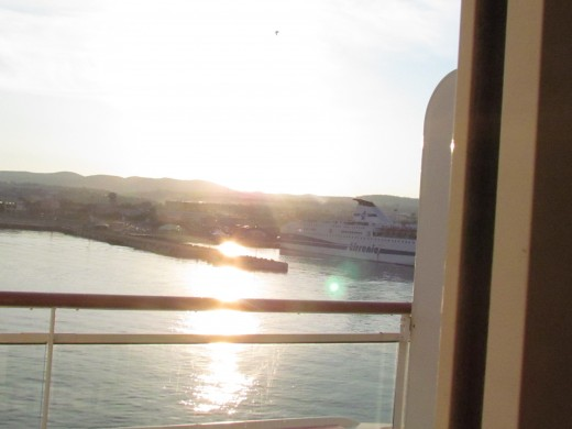 A magnificent appearance of the sun across the water in Livorno.