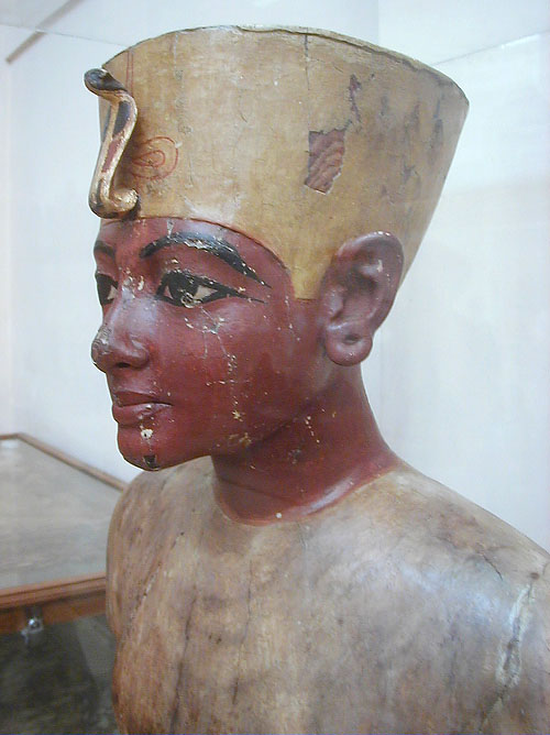 Wooden bust of boy king, found in tomb. By Joh Bodsworth