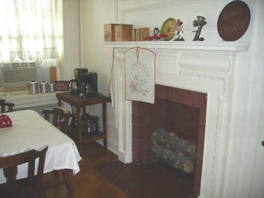THIS IS OUR KITCHEN-YOU CAN SEE THE CANISTER SETS, ROOSTER ITEMS, AND LARKIN'S GRINDER ON THE MANTLE...