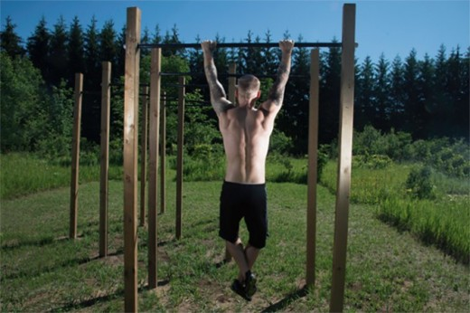 A passive bar hang is a great way to start getting used to your body