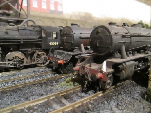 Locos lined up outside Ayton Lane's dilapidated shed. On the far left is 4MT 43054, centre K3 61927 and nearside WD 2-8-0 90446 (all Bachmann products)