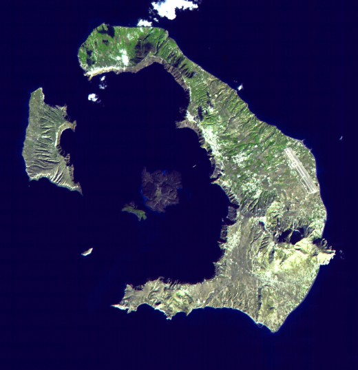 Satellite image of Santorini caldera. The large island to the east is Thera, with Aspronisi and Therasia making up the rest of the caldera ring, clockwise. In the centre is the larger Nea Kameni and the smaller Palea Kameni.