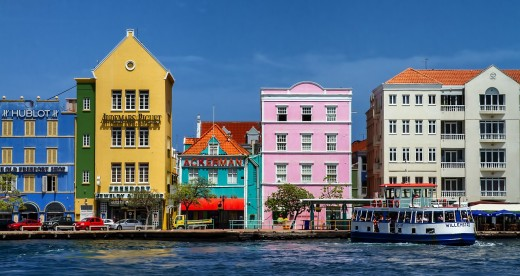 The vibrant and colorful Handelskade waterfront is one of the island's most famous and popular attractions. Source: Pixabay public domain