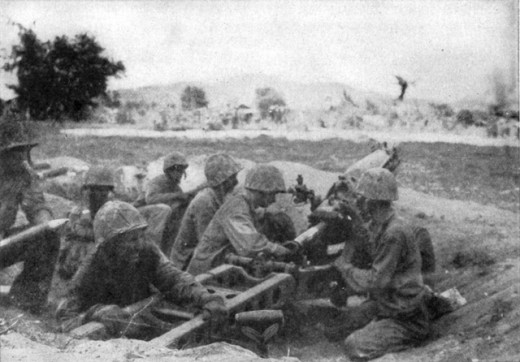 A 10th Marine Regiment 75mm pack howitzer crew in Saipan