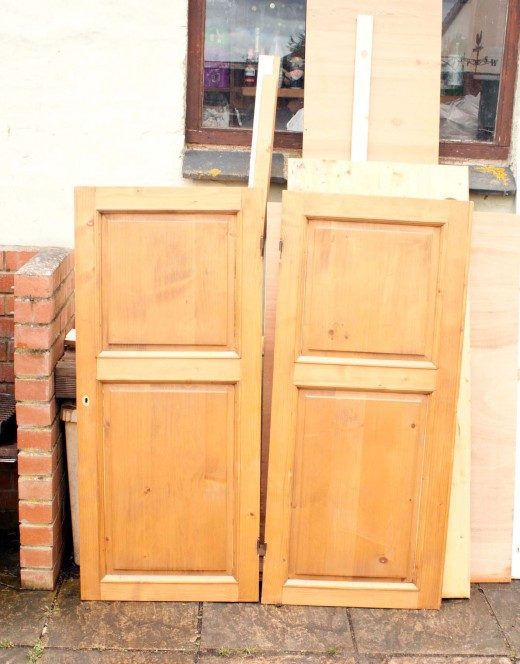 Repurposing doors from an old pine wardrobe to make a door for a built-in wardrobe.