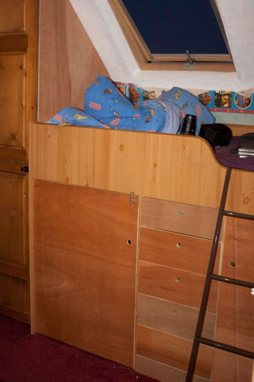 Full depth storage area and drawers recreated under the bed using recycled wood for solid pine drawers and plywood sheet for the doors.