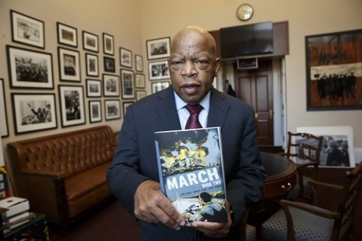 Congressman John Lewis holds a copy of March, Book 2, the second volume of his graphic memoir of his years as a civil rights activist.
