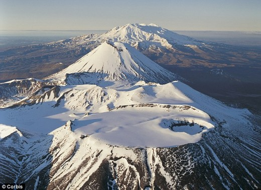 Ruapehu, Ngauruhoe. and Tongariro all in a line. Three 'cones' part of the same complex