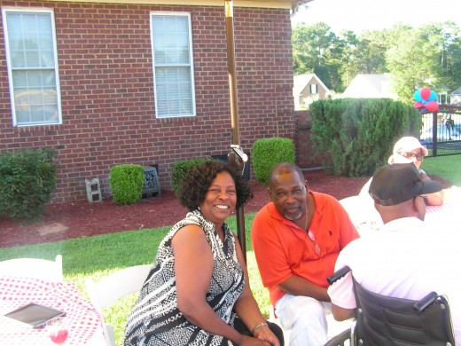 Deborah and her husband enjoy the barbeque and pool party at Ann and David's house on Friday with their classmates.