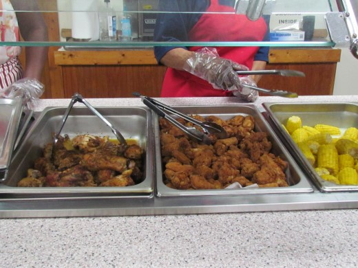 Delicious food was served such as fried chicken, pasta salad, mixed vegetables and fresh rolls.