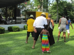 Line dancing was performed in the park during the cookout.