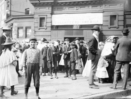 Newsboys stand outside the Armory at 7th and Wabash before Volunteers of America Picnic on June 26, 1902.
