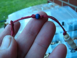 use square knots to hold the beads in place if you like or they can be left to slide