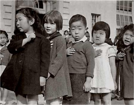One week these children are saluting the American flag; a short while later they would be relocated to an internment camp.