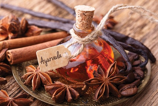 Ayurvedic tag attached to pure oil and cinnamon sticks.