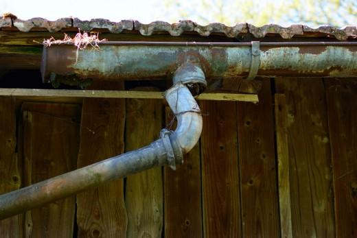 Broken roof gutter needing repair.