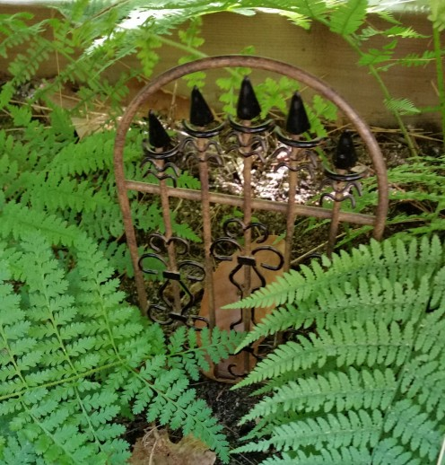 Isn't this metal gate a delight. When I spotted it at a rummage sale, I knew it would look perfect in my ferny garden. Then I could place one of my fairy figures further in, so it would look like she came through the gate.