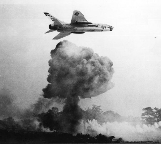 """1st MAW F-8 """"Crusader"""" conducting a close air support mission in South Vietnam, 1966."""