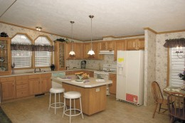 This mobile home is designed with a modernized kitchen.
