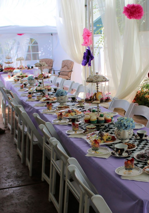 An Alice in Wonderland tea party setting.