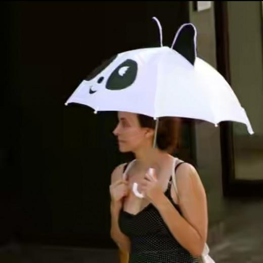 Funny umbrella resembling a panda