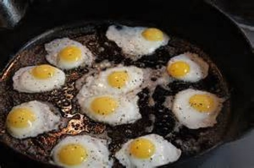 a pan full of fried quail eggs